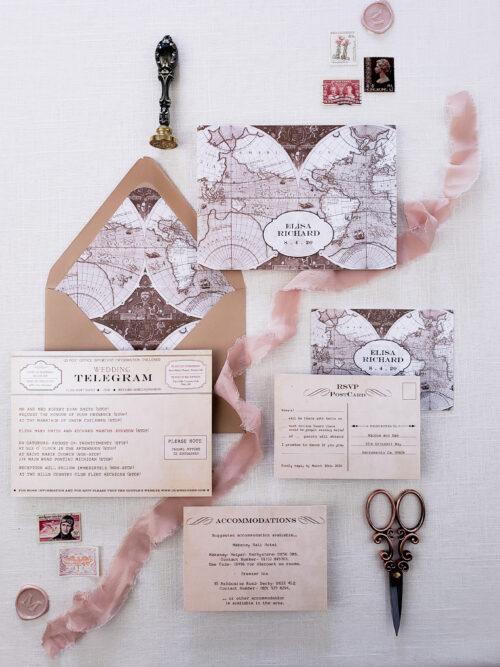 world map and telegram themed stationer