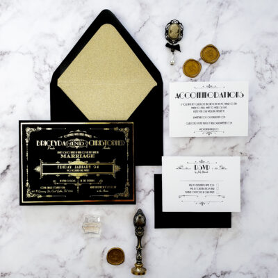art deco style black and gold wedding invitations with gold wax seal