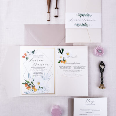 cream envelope with pops of color and flatlay wax stamps