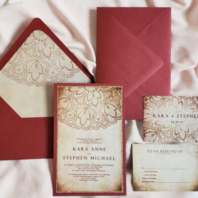 scarlet envelopes with cream paper and lace