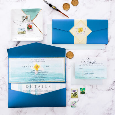bright blue envelopes and stationery with glass pen and wax seal