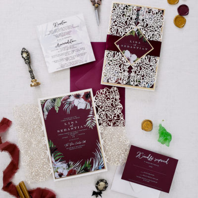 wedding invitations with purple and white detailing