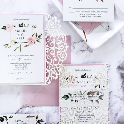 white stationery with pink border and flowers