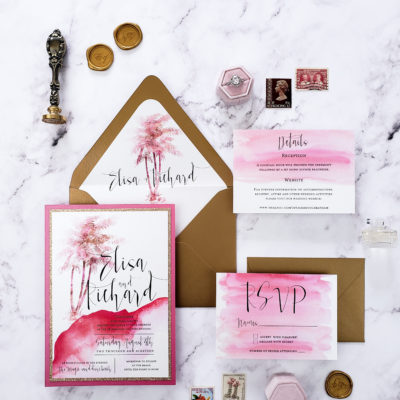 watercolor pink-themed stationery with brown envelope and gold wax seal
