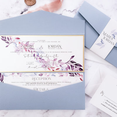 periwinkle envelopes with white stationery and watercolor leaves