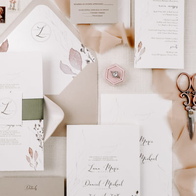 pink themed stationery and ring
