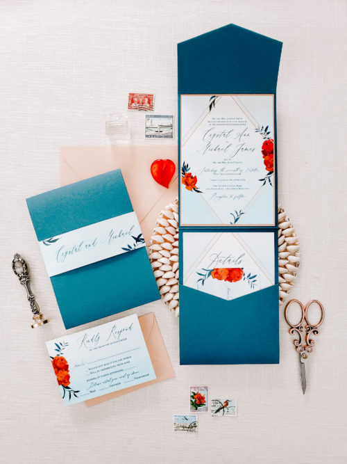 bright blue envelopes with pops of red and a wax seal flatlay