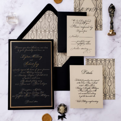 black cream and gold stationery set with vintage wax stamps