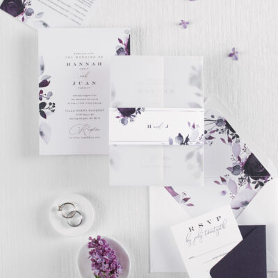 purple and white stationery with flowers on bellyband