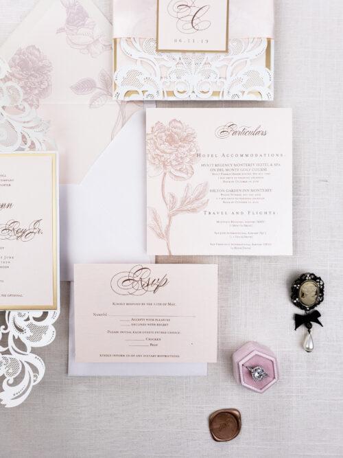 white laser cut invitation