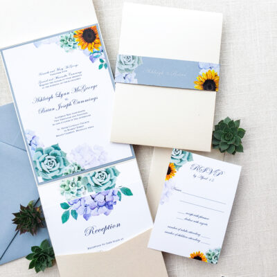 blue envelope with stationery with flowers and succulents