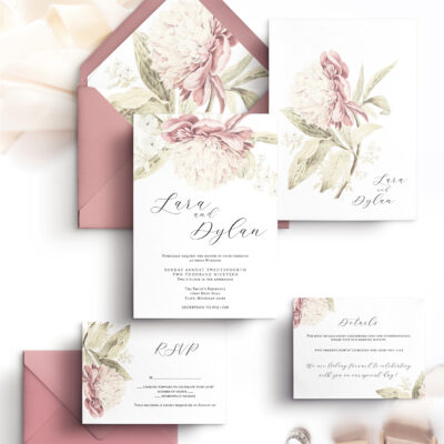 pink envelopes and white stationery with flowers
