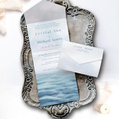 nice wedding invitation on tray water inspired