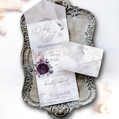 rome wedding invitation on tray