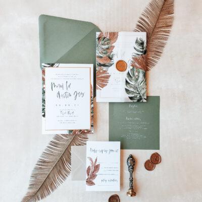 green envelopes with orange and green leaf design
