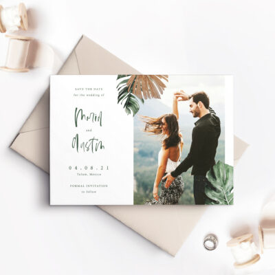 save the date card with picture of couple and ferns