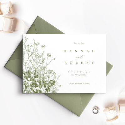 save the date card with green envelope and flowers