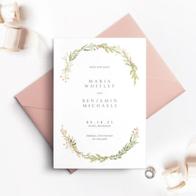 pink envelope with white card and wreath