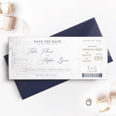 dark blue envelope with travel inspired save the date card