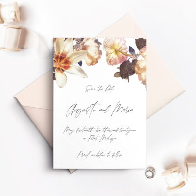 white save the date card with envelope and flowers