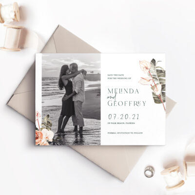 slate gray save the date card with photo of couple and flowers