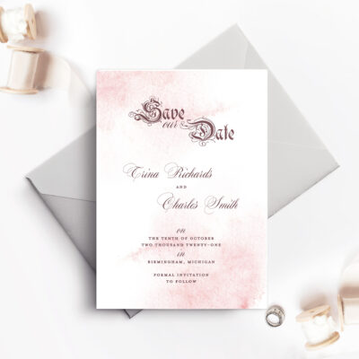 save the date card with pale blue envelope and light paint spray design