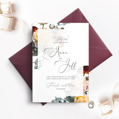 maroon envelope with white card and floral corner borders