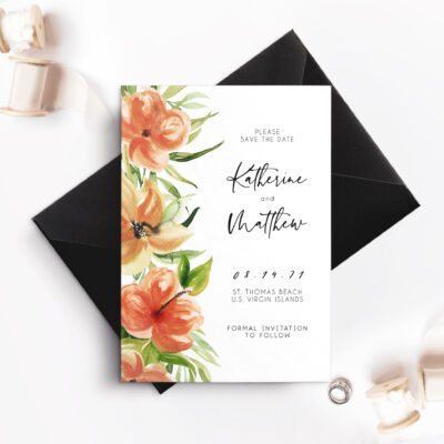 black envelope with white card and red flowers